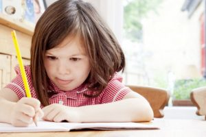 landscape-1439477408-girl-doing-homework